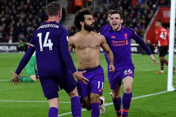 Liverpool score twice late to go back to the summit