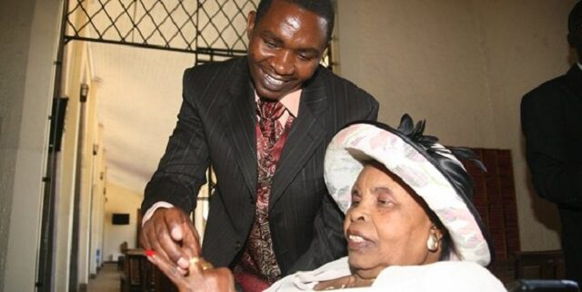 Peter Mbugua, widower to Wambui Otieno has remarried on Sunday in a colorful ceremony at the Christian fellowship Church. Peter Mbugua hit the headline when he married 67-year-old Ms. Virginia Wambui Otieno in 2011 when he at the age of 25. The naïve Peter Mbugua faught all norms but the freedom fighter passed away on August 30th 2011 and was buried in Ngong ending their marriage. On Monday, Mr. Peter Mbugua was celebrated again but now wedding the mother of his children who is 10 years younger than him. Mr. Peter is currently 45-years-old. Peter Wambui controversial wedding. In 2011 when the the couple Peter Mbugua and the late Wambui Otieno came public of their relationship, they completely received backlash from the society due to their age difference. In August when Wambui passed away, Peter was kicked out of their Matasia home by his step-daughters as property tussles brewed. The widower was forced to go underground for some time, start a fresh life possessing nothing but the marriage certificate