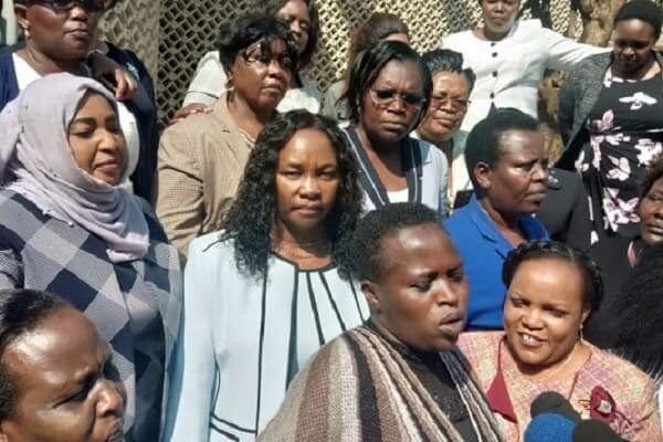 Women MPs protest outside parliament