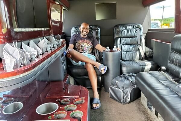 Boniface Mwangi inside the private jet