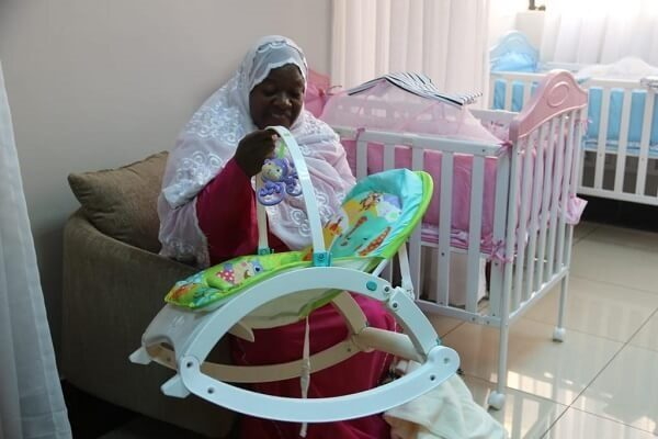 Kwale Women Rep familiarizing with the new baby nursery