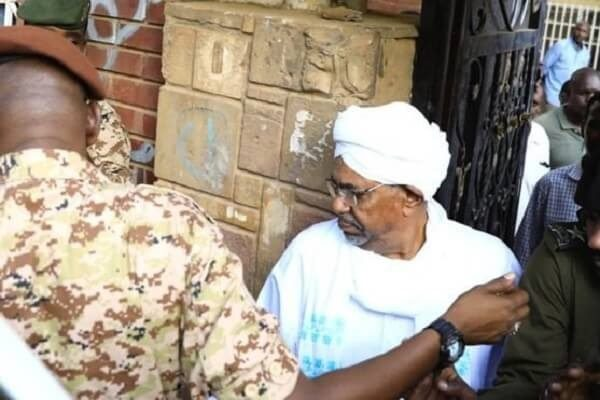 Omar al-bashir arrives in court to answer to corruption charges